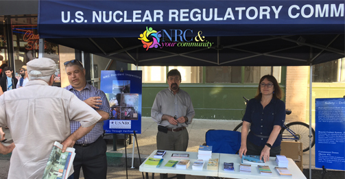 An NRC Region IV team staffs a booth at the San Luis Obispo Market Night to speak with local residents about the agency's role in overseeing nuclear plants, including the nearby Diablo Canyon site.