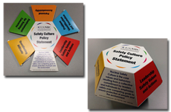 Photo of colapsible, cardboard pop-ups available, which are convenient desktop references for the Safety Culture Policy Statement definition and traits; they are hexagon shaped with information on each side of the various colored tabs