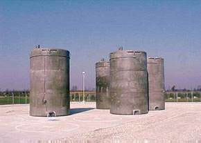 Photo of dry cask storage made of stainless steel canisters surrounded by concrete
