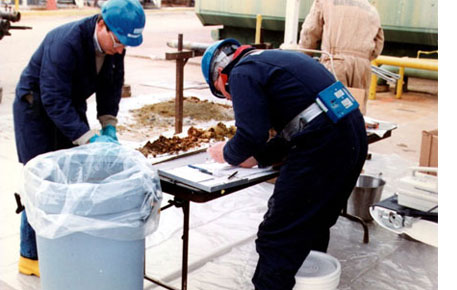 Environmental Monitoring image of Technicians process soil samples