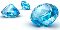 Image with three blue cut gemstones on a white background.