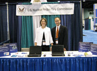Angela Randall and Andrew Mauer of the NRC at the AAPM Vendor Fair.
